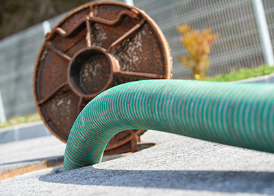 Septic cleaning and sewage removal. Emptying household septic tank. Cleaning sludge from septic system.